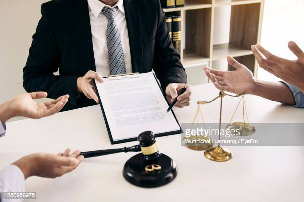 midsection of people on table - courthouse stock pictures, royalty-free photos & images