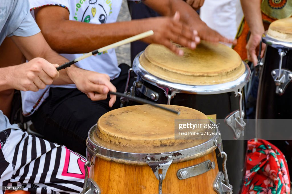 Midsection Of People Playing Drum : Photo