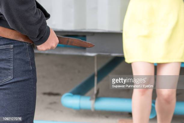 midsection of people standing outdoors - sexual violence stock pictures, royalty-free photos & images