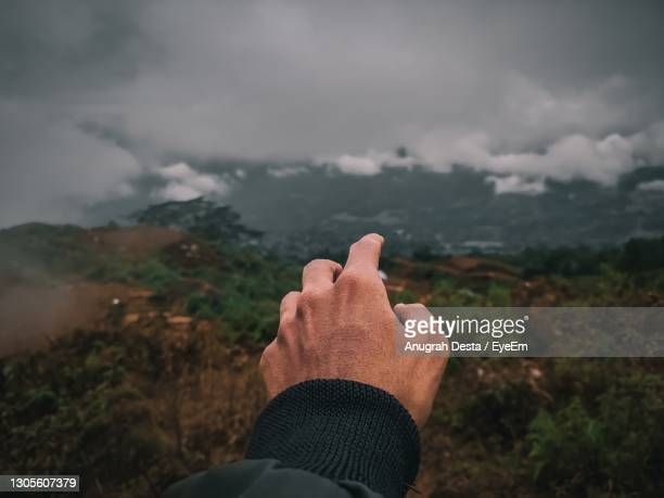 midsection of person against sky - formal glove stock pictures, royalty-free photos & images