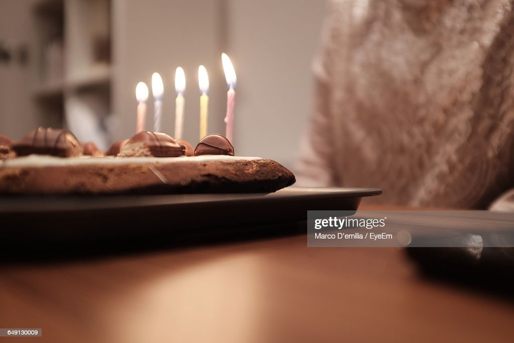 Midsection Of Person By Birthday Cake On Table Stock Photo Getty