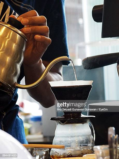 Midsection Of Person Filtering Cold Brew Coffee