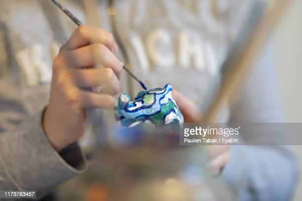 midsection of person painting decoration - paulien tabak stock pictures, royalty-free photos & images