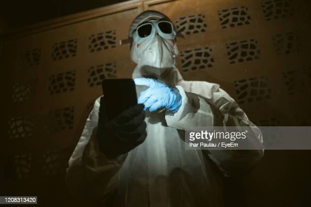 midsection of person photographing with mobile phone - chernobyl nuclear power plant stock pictures, royalty-free photos & images