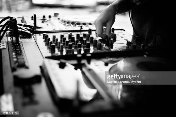 midsection of person playing music - deck stock photos and pictures