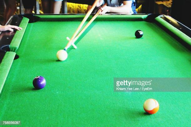 Midsection Of Person Playing Pool