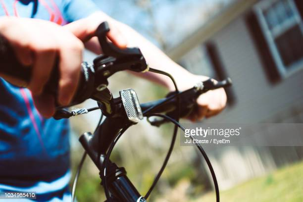 Midsection Of Person Riding Bicycle