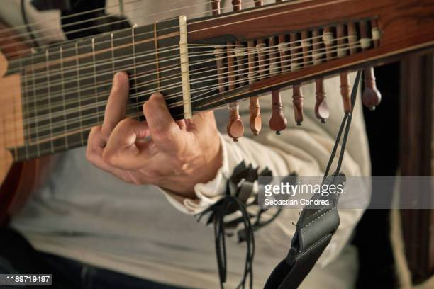 midsection of person singer on guitar. - folk music stock pictures, royalty-free photos & images