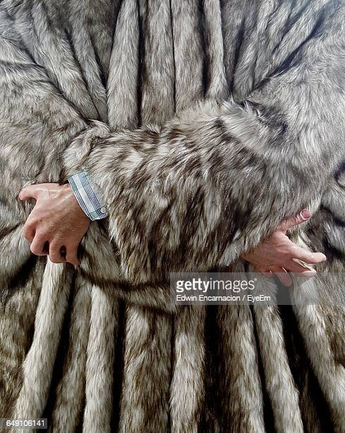 Midsection Of Person Wearing Fur Jacket During Winter