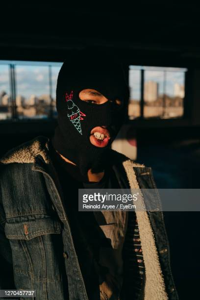 midsection of person wearing mask standing outdoors - social movement stock pictures, royalty-free photos & images
