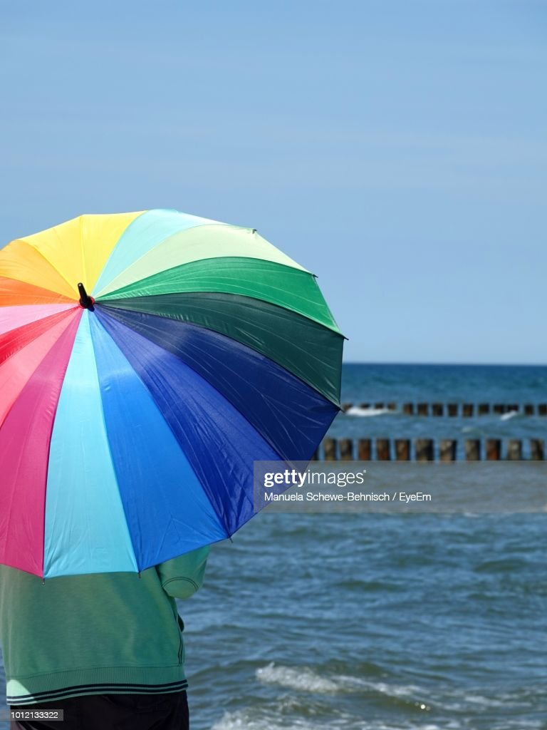 Colorful Umbrella Standing At Beach