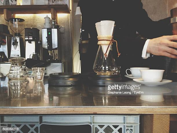 Midsection of person working in cafe
