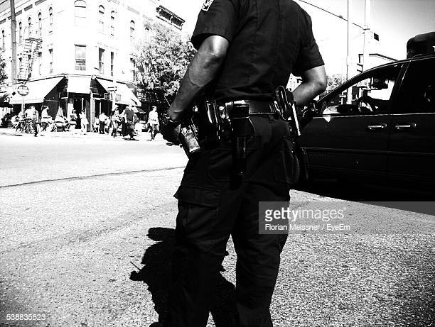 midsection of police officer with walkie-talkie on equipment belt - police uniform stock pictures, royalty-free photos & images