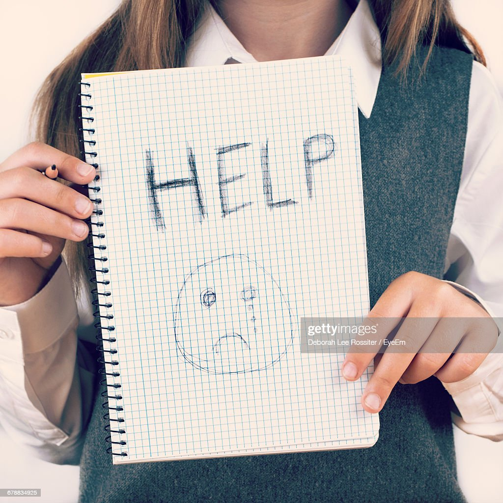 Midsection Of School Girl Against Wall : Stock Photo