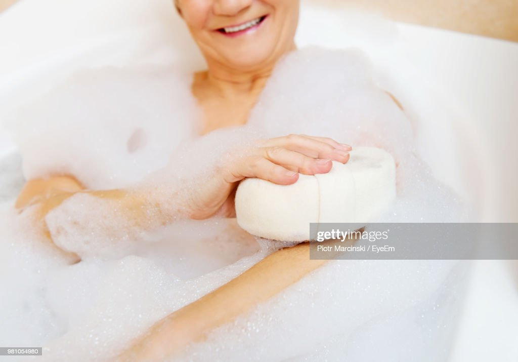 Midsection Of Senior Woman Taking Bath In Bathtub Stock Photo ...