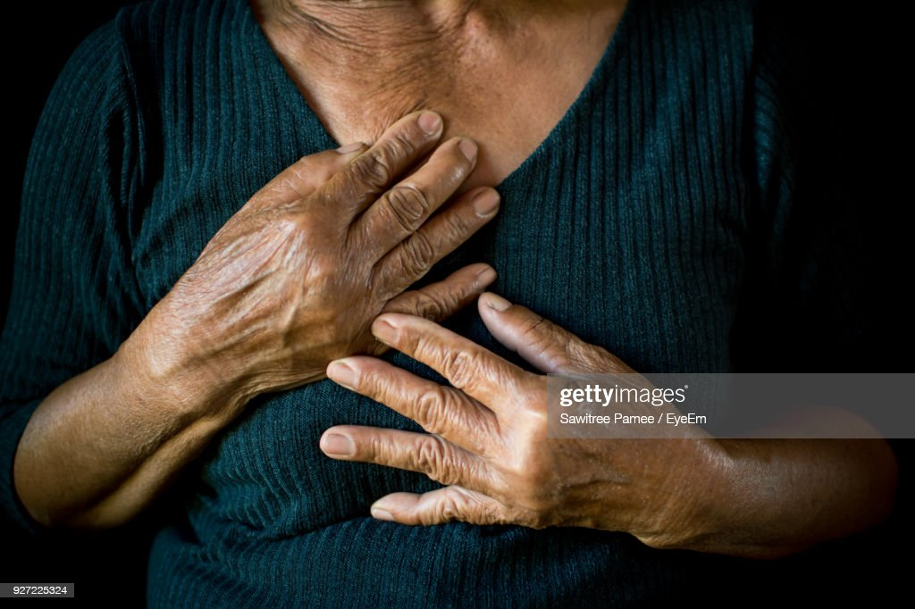 Midsection Of Senior Woman With Hands On Chest : Stock Photo