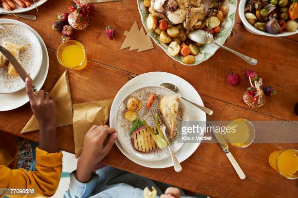 midsection of sisters having meal at home - holiday stock pictures, royalty-free photos & images