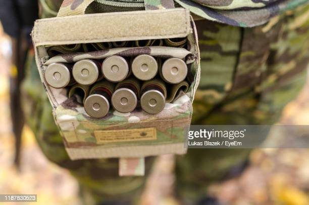 midsection of soldier carrying bullets in waist pack - weaponry stock pictures, royalty-free photos & images