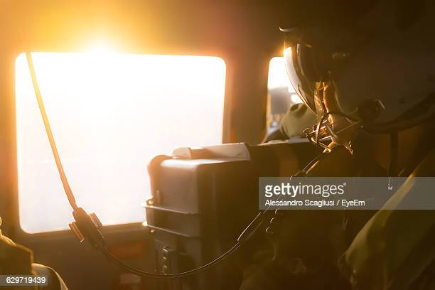 Midsection Of Soldier Traveling In Helicopter
