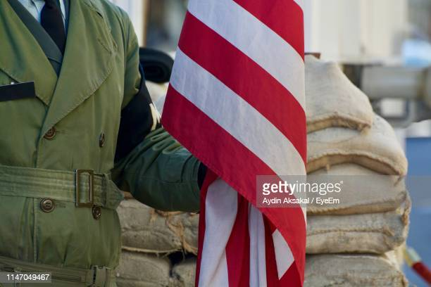 Midsection Of Soldier With Flag