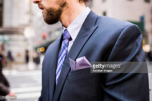 midsection of well-dressed businessman standing on city street - purple suit stock pictures, royalty-free photos & images
