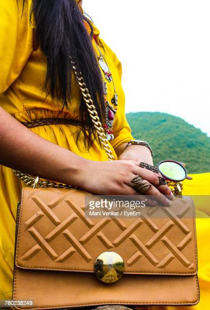 Midsection Of Woman Carrying Purse