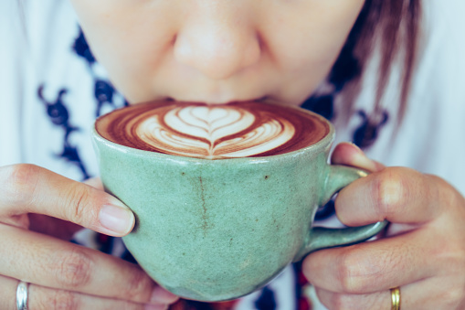 Midsection Of Woman Drinking Coffee - gettyimageskorea
