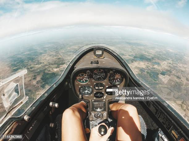 midsection of woman flying airplane over landscape - control stock pictures, royalty-free photos & images