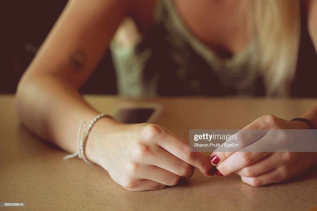 Midsection Of Woman Hands On Table : Stock Photo
