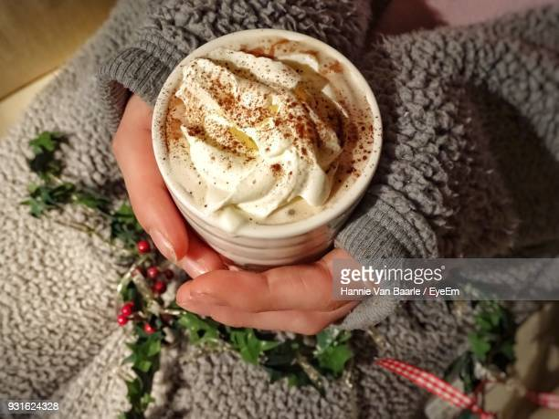 Midsection Of Woman Having Hot Chocolate