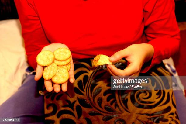 Midsection Of Woman Holding Biscuit