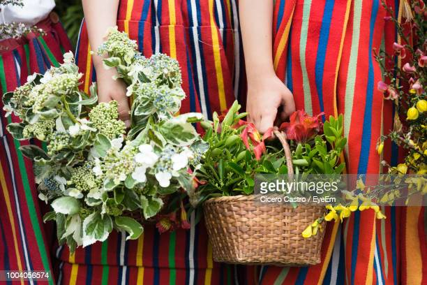 midsection of woman holding bouquets - funchal stock pictures, royalty-free photos & images