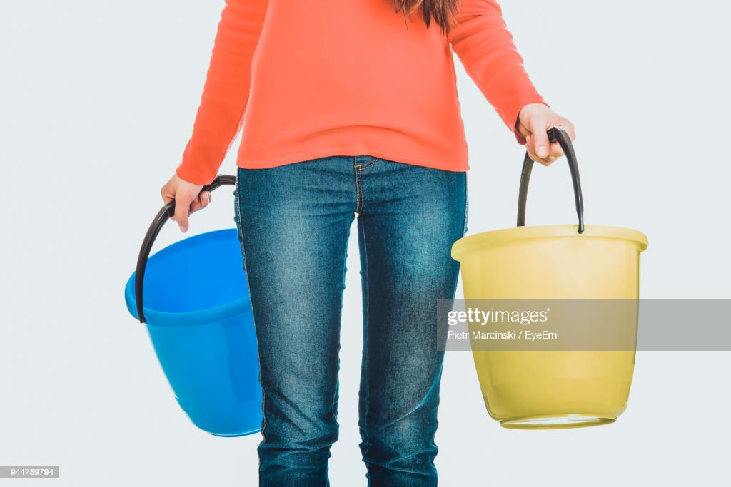 Midsection Of Woman Holding Buckets : Stock Photo