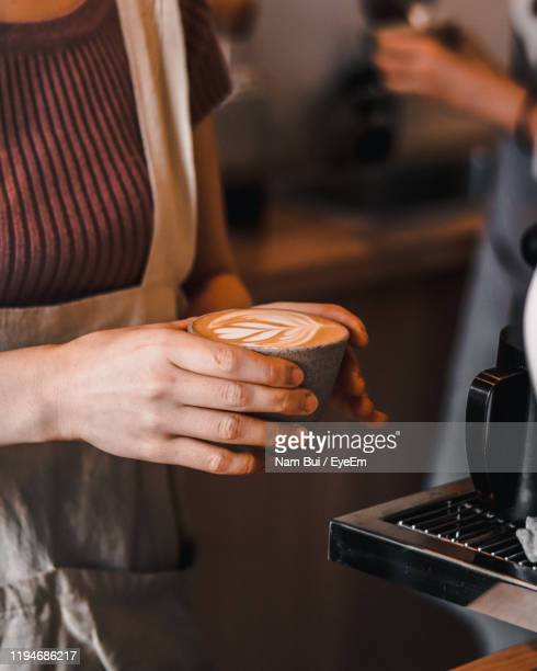 midsection of woman holding coffee - mid section stock pictures, royalty-free photos & images