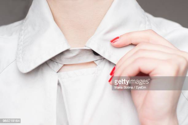 midsection of woman holding collar - collar stock pictures, royalty-free photos & images