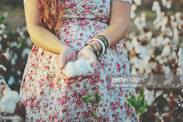 Midsection of Woman Holding Cotton