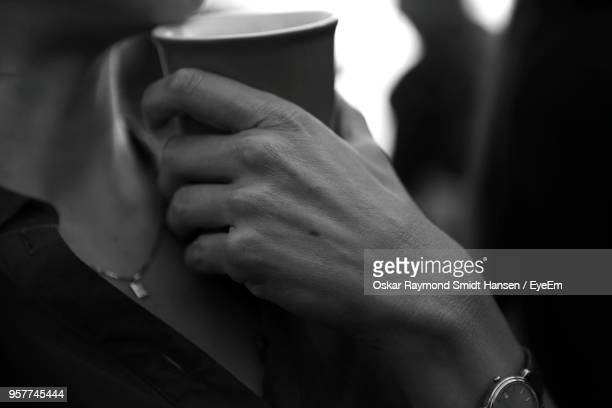midsection of woman holding cup - oskar stock pictures, royalty-free photos & images