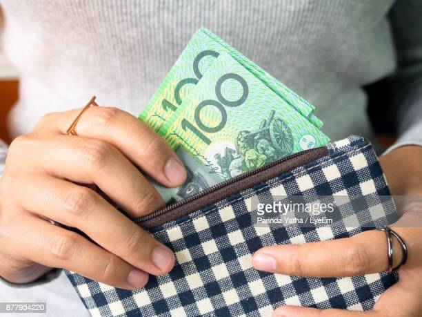 Midsection Of Woman Holding Currency