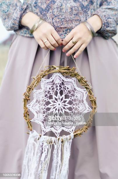midsection of woman holding dreamcatcher - dreamcatcher stock pictures, royalty-free photos & images