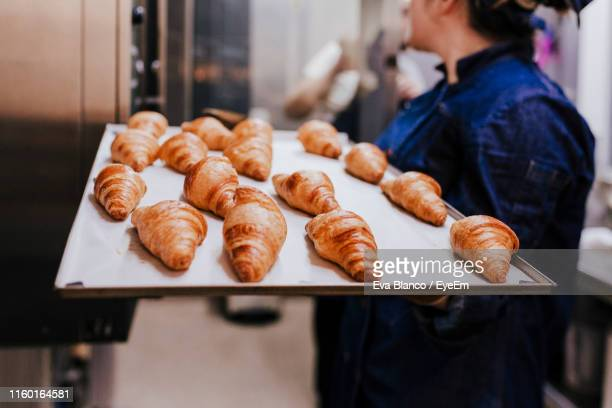 midsection of woman holding food in tray at bakery - french food stock pictures, royalty-free photos & images