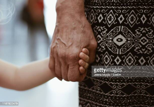 midsection of woman holding hand child hand - jelena ivkovic stock pictures, royalty-free photos & images