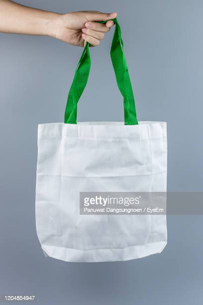 midsection of woman holding paper against white background - 0 1 months stock pictures, royalty-free photos & images