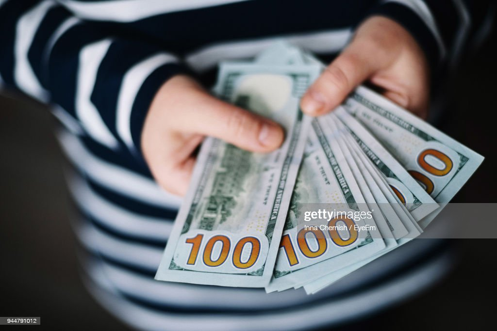 Midsection Of Woman Holding Paper Currency : Stock Photo