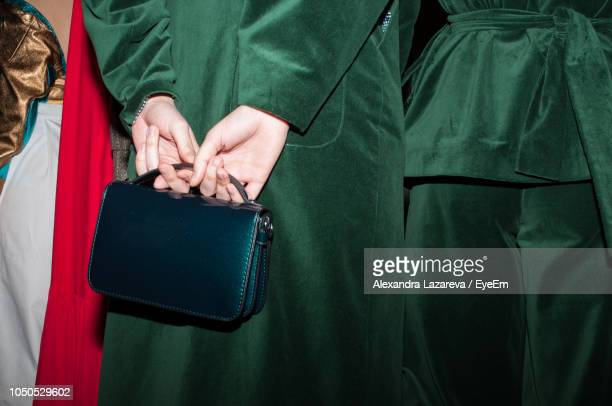 Midsection Of Woman Holding Purse
