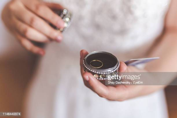 midsection of woman holding ring in jewelry box - 宝石箱 ストックフォトと画像