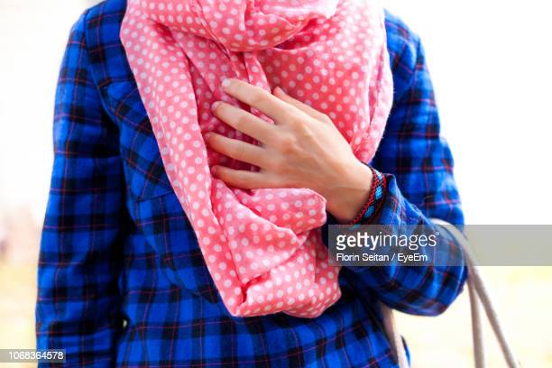 midsection of woman in blue checked top with pink spotted scarf - florin seitan stock pictures, royalty-free photos & images