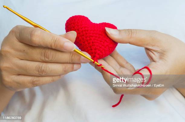 midsection of woman knitting - wool stock pictures, royalty-free photos & images