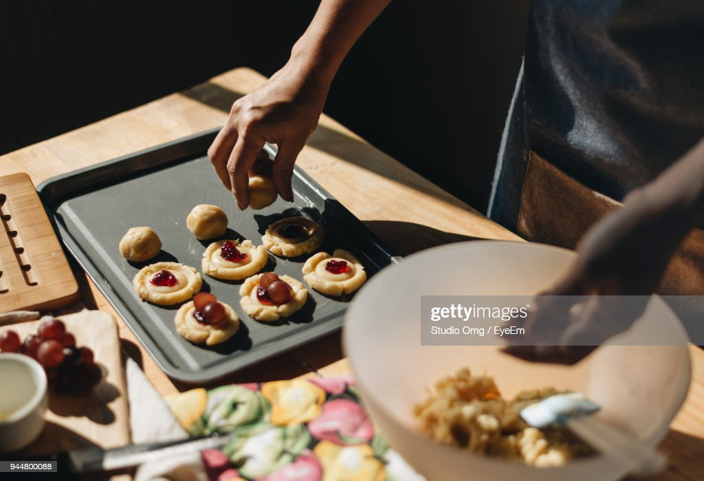 Midsection Of Woman Making Food At Table : Stock Photo