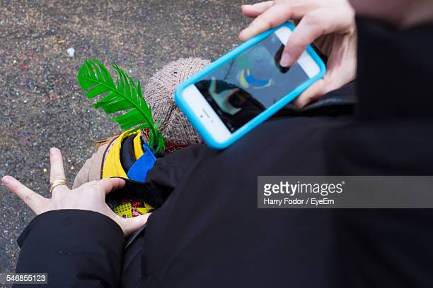 Midsection Of Woman Photographing Candies In Pocket