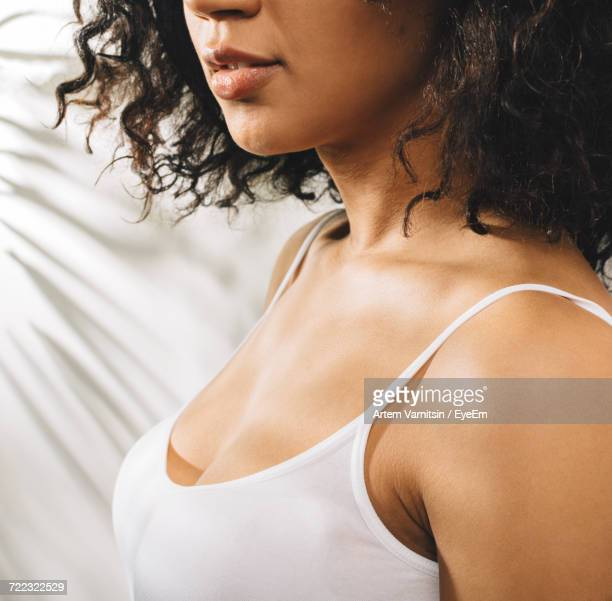 midsection of woman - cleavage stock pictures, royalty-free photos & images